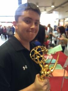 DJ holding an Emmy